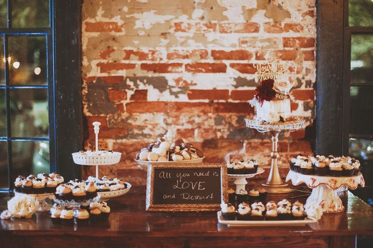 Rustic and elegant winter wedding display featuring cake, cupcakes, & macarons by Flavor Cupcakery