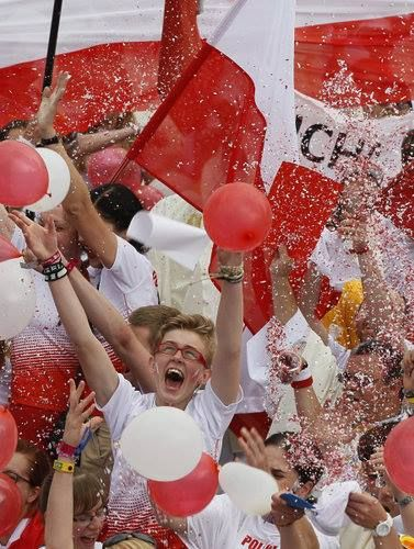 Polish pilgrims in Rio de Janeiro cheer as Pope Francis announces that World Youth Day 2016 will take place in Krakow, Poland. The pope made the announcement at the conclusion of the closing Mass of World Youth Day on Copacabana beach July 28. (Catholic News Service photo/Paul Haring) #rio2013 #krakow2016 #WYD