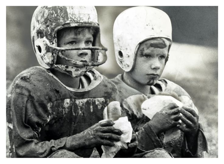 """Little league football playing brothers eat hot dogs after their game on November 18, 1960"""