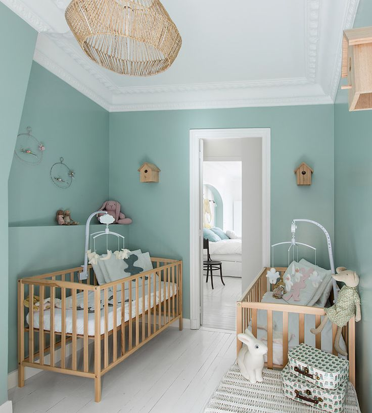 Warm wood and playful turquoise color in the nursery room. Designed by Hauvette & Madani.