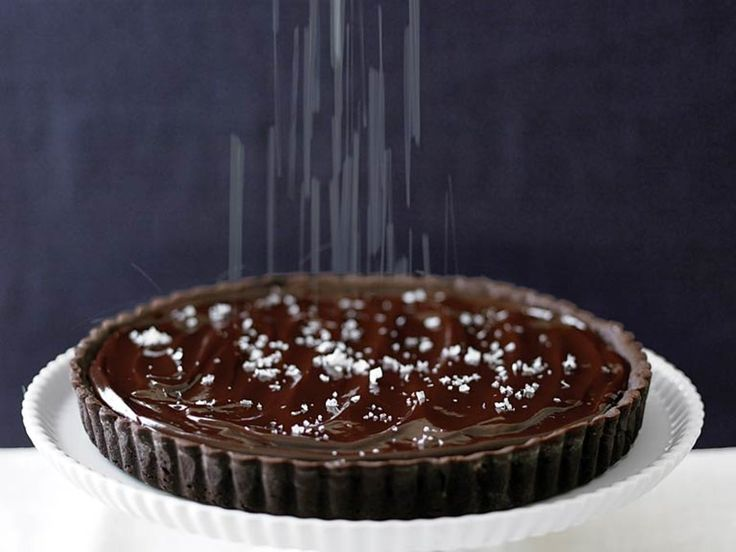 We prefer Maldon sea salt for sprinkling onto this chocolate tart. Its large flakes look striking against the glossy chocolate surface,...