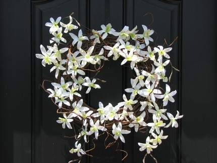 white orchid wreath- could also serve as a center piece with candles