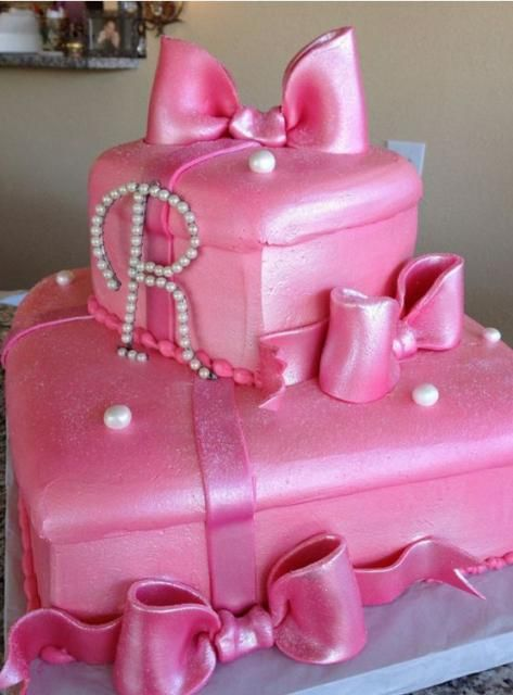 Two tier pink gift box cake with pearl monogram - could be cute for a Minnie Mouse birthday party, or Princesses