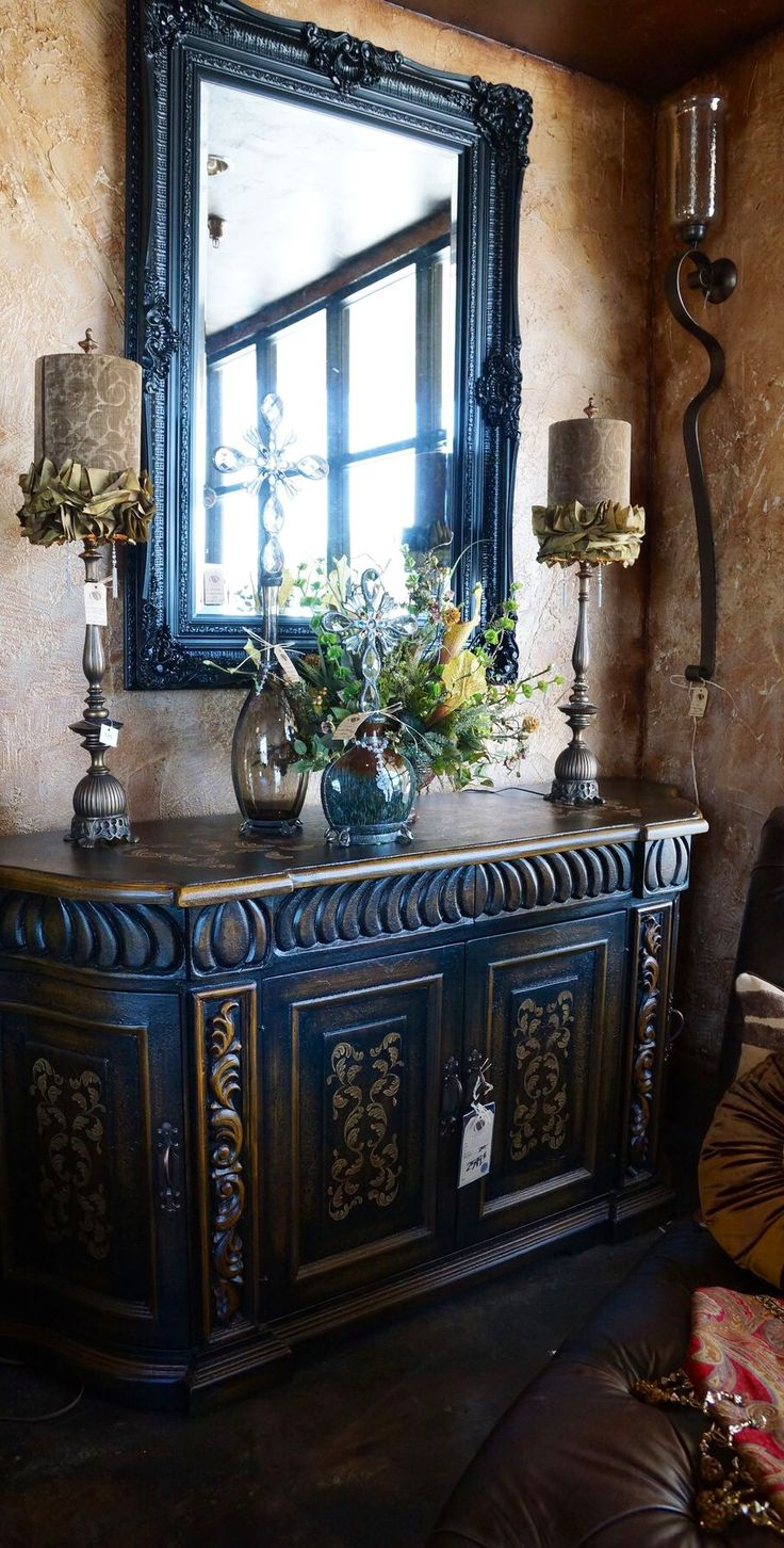 Lovely statement piece cabinet.   I'm always perplexed by designer's who choose flammable materials to embellish candles.  Having had a fireman in the family and hearing frightening tales, I'm all too aware of the potential for tragedy.  Why invite it?