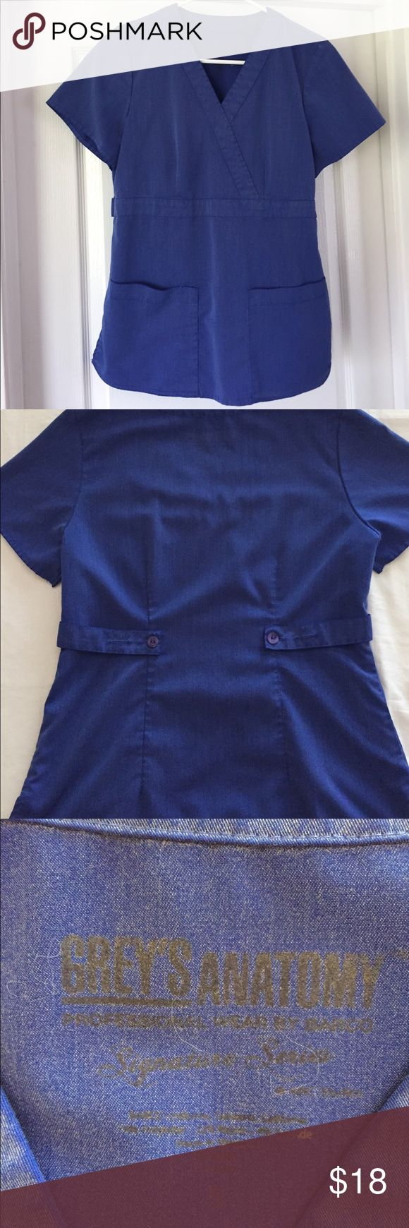 Grey's Anatomy Scrub Top Heather Grey's Anatomy Scrub top. Style is the mock wrap top fitted with 3 pockets and button tabs. Near perfect condition. Size small. Grey's Anatomy Tops