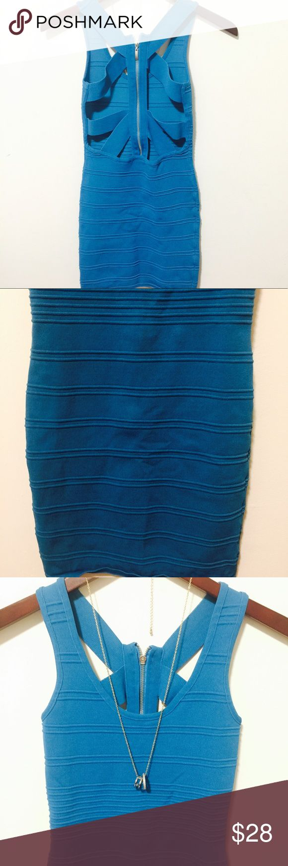🆕TEAL CROSS BACK SEXY ZIPPER BANDAGE DRESS SM SUPER SEXY TIGHT CURVY BANDAGE CROSS BACK ZIPPER DRESS LAST ONE!!!!! HAVE SOLD ALL!!!! SIZE MED LEN 30 PIT TO PIT 13 PLEASE ASK ANY QUESTIONS ❤️❤️NEW INVENTORY❤️❤️  ✅BUNDLE AND SAVE ON SHIPPING 20% OFF ON ANY BUNDLES MY PRICES ARE GREAT AND THERE NWT OR NWOT UNLESS STATED  THERE NAME BRAND SELLING THEM FOR CHEAP✅  ***DONT FORGET TO FOLLOW I DELETE AND RELIST***  # GREAT DEALS Metropark Dresses Mini