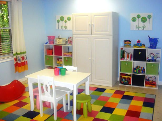 Children's spaces should be fun. This playroom by RMS incorporates a rainbow of colors underfoot and walls of sky blue. White furniture and bookcases for storage complete this smart look.  CHECK OUT..Chip It! New from Sherwin-Williams.  ABOUT THIS APP  A color tool that generates a color palette for any online picture using over 1500 paint colors.