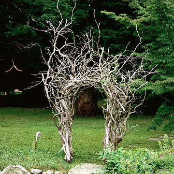 Make a statement with uncommon materials in your garden. Some driftwood and DIY handiwork crafted this spectacular arbor.