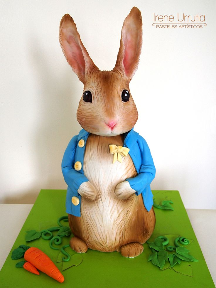 3d Peter Rabbit cake by Irene Urrutia - Pasteles artísticos. Chocolate head and ears, carrot cake with crusting cream cheese frosting and white chocolate ganache body. Decorated with fondant.