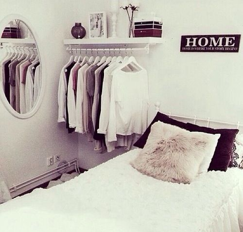 Cute open closet idea for guest bedroom. That way the actual closet can be used as extra storage. Still loving the crisp white rooms.