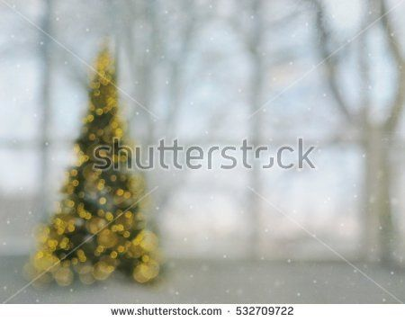 christmas tree - blur defocused light celebration with tender colored window background  and snow
