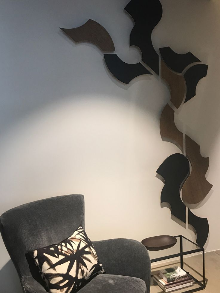 A combination of Move and XOX shapes in dark oiled oak and dark grey zinc create a stylish and unique wall sculpture. Complements and balances the other interior very nicely.
