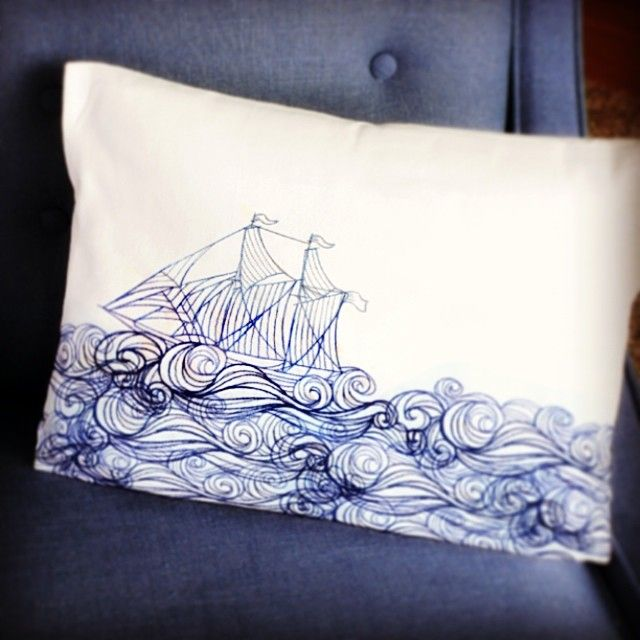 Stitch this repeating ship and waves design to create chic nautical home decor with your embroidery machine.
