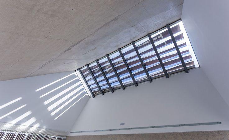 juan carlos salas' tanatorium filters sunlight through concrete chimney