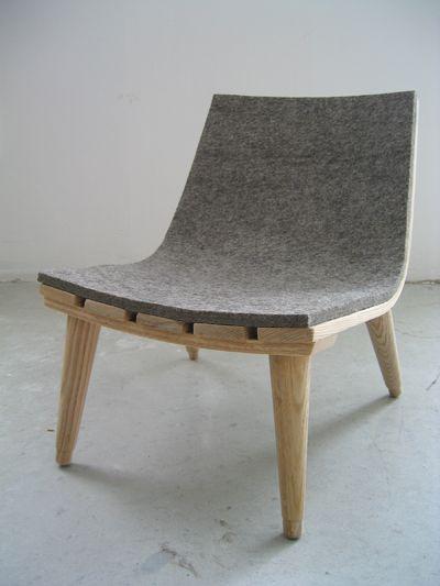 stream line minimal felt and timber chair.