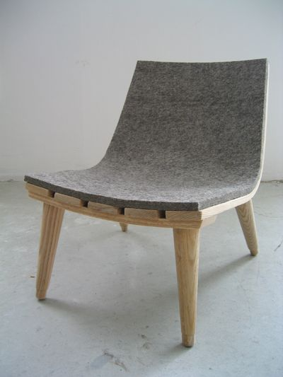 stream line minimal felt and timber chair.