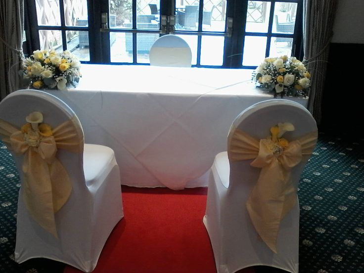 Ceremony set up in tones of pale yellow and white