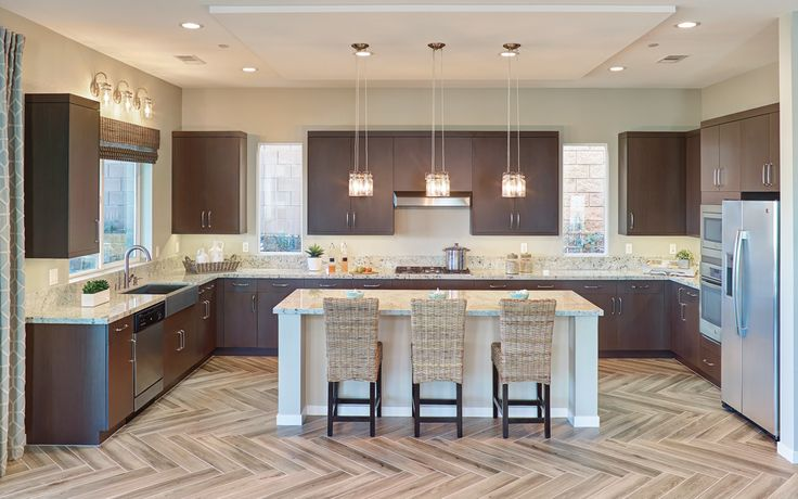 This Urban Effects Cabinetry kitchen was designed with the Rio door style in Melamine finished in a dark brown cabinet color called Smoke. #urbaneffectscabinetry