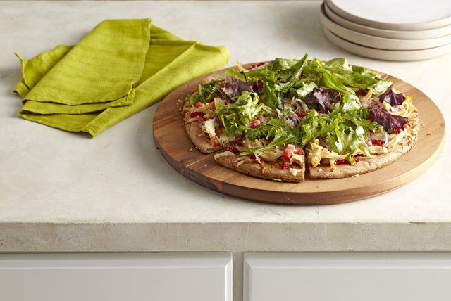Skip the same-old pepperoni pizza and go for a zesty chicken pizza instead.  Topped with peppers, chicken, onions, tomatoes, mozzarella and fresh salad greens, our Mediterranean Chicken Pizza is sure to be a hit at your next pizza night.