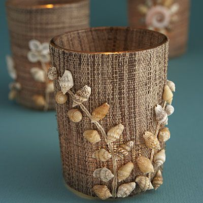 What's not to love about this trio of tiny shell votives? Shells are an easy beachy home accessory, plus the woven raffia gives it that extra oomph of texture./ can use all my tiny shells