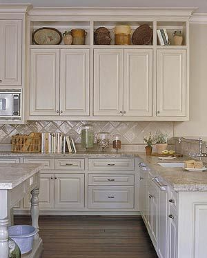 Add to top of cupboards to make taller, end backsplash on continuing wall, maybe raise some cupboards for microwave like this too.