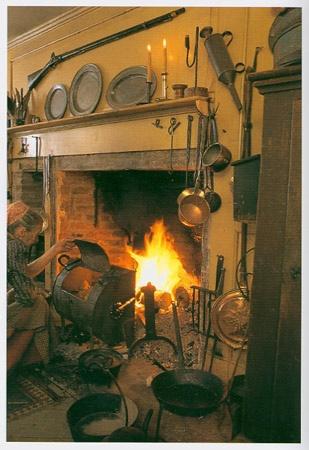 Tasha Tudor at hearth cooking turkey in tin kitchen