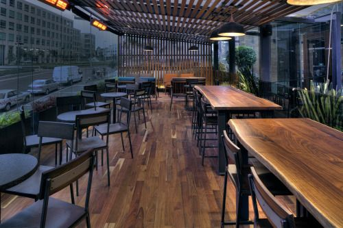 Mexico City, Mexico: Mexico's first Starbucks Reserve Store features a carefully curated line of small-lot arabica coffees from Nicaragua, Papua New Guinea, and the Galapagos. Designers intentionally kept the indoor space open, with limited bar...