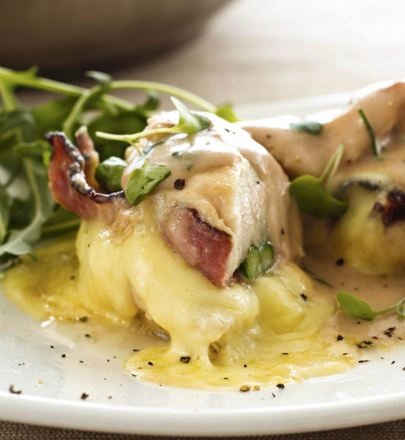 Chicken breast stuffed with cheese & asparagus in a creamy marsala wine sauce. Italian food at it's absolute best.