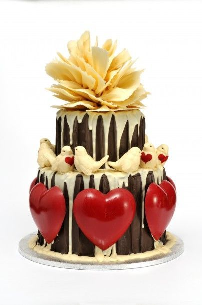 A great romantic cake with love birds and giant red hearts. Amazing cake by Choccywoccydoodah