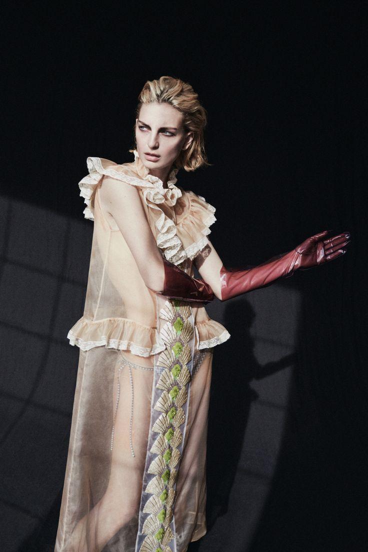 Miu Miu's organza dress and cotton bottoms. Gaspar gloves. [Photo: Billy Kidd]