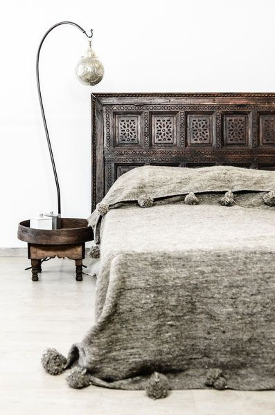 Old Architectural piece as headboard. For similar Moroccan Pom Pom blankets see our collection here: www.maudinteriors.com