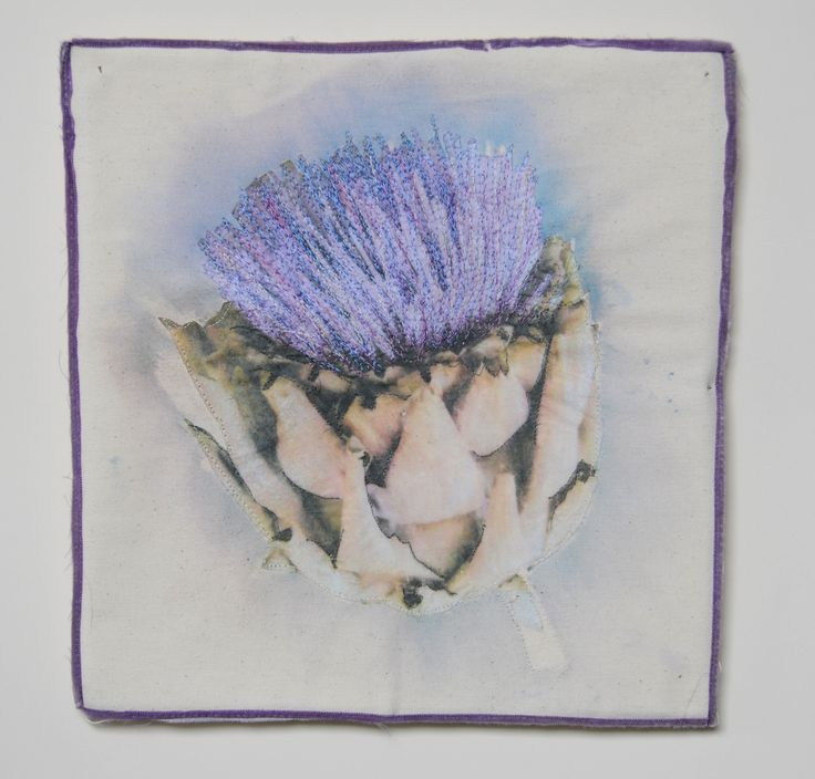 Artichoke image transfer with applique and free machining.