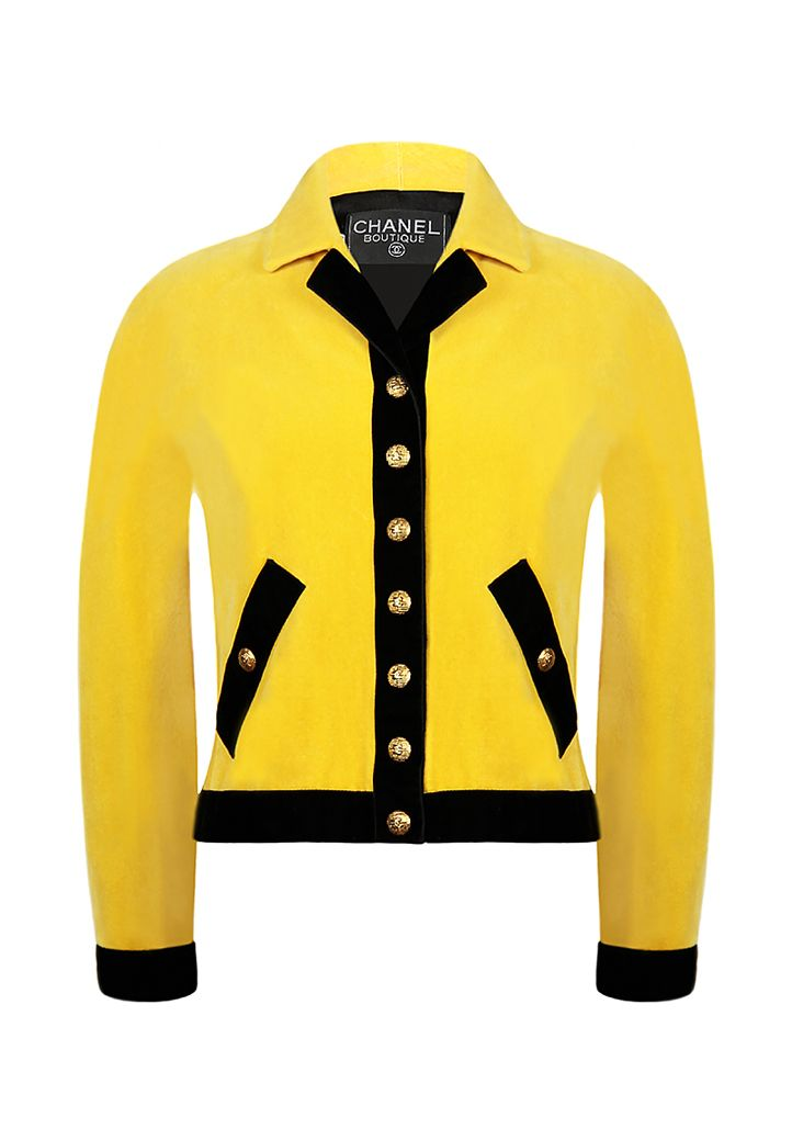 Vintage Chanel jacket in sunny yellow velvet on a silk lining. Straight silhouette jacket, magyar sleeve, stand-up/turn-down collar and buttons with the brand's logo. Breastline, pockets, jacket and sleeve hem decorated with wide black velvet ribbon.