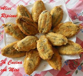 Alici ripiene impanate e fritte una ricetta con pochi ingredienti, un piatto del sud dove le alici sono di casa è un pesce povero, ma è un pesce fresco