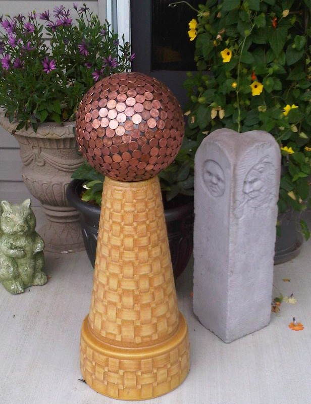 How to make fun and unique yard art made from a bowling ball. And some people say the copper pennies repel slugs!