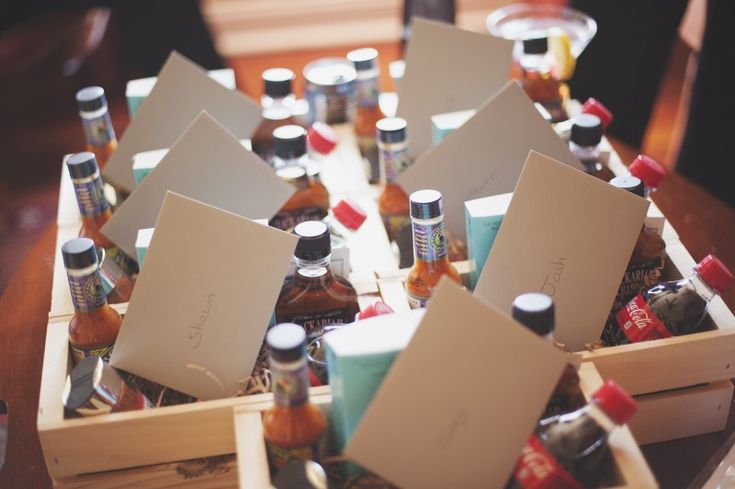 Groomsmen Gift Ideas. Groomsmen gift basket: whiskey, coca-cola, dry-rub for BBQ, groom's favorite book, and hot sauce!  What men does not love this?  from the blog: draftsandcrafts.net  One Year of Marriage + My Wedding DIY's