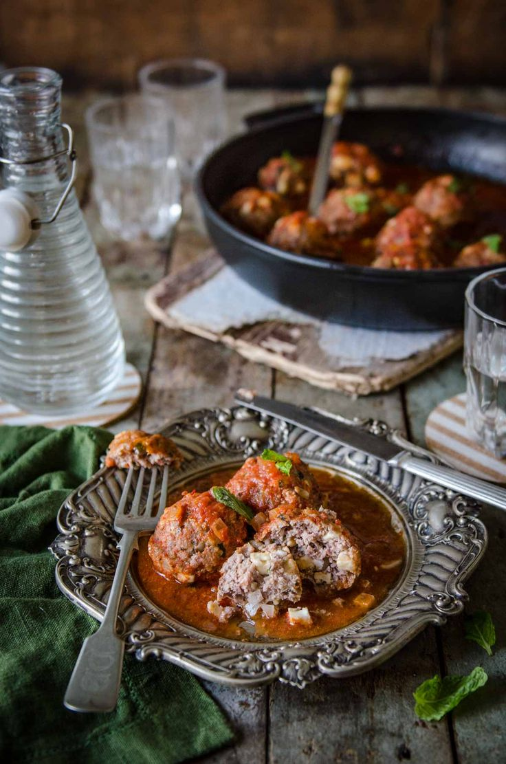 One-dish Greek lamb meatballs with feta, pine nuts, mint and cinnamon in tomato sauce