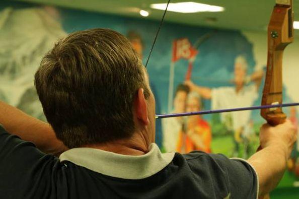 Blind Veterans UK member Carl Adamson takes aim in a fun archery competition  Photo credit: blind veteran Chris Nowell #BlindVeteransUK #BlindedVeteransAssociation #BVA #ProjectGemini