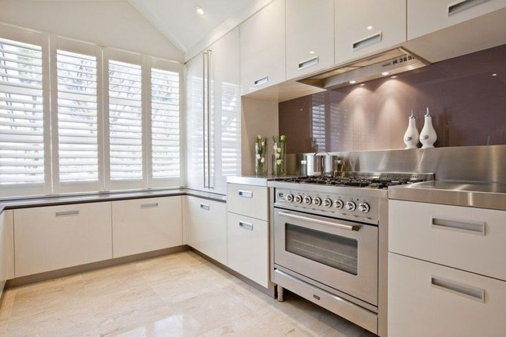 Kitchen With Stainless Steel Freestanding Oven And White Cabinets A Freestanding Oven For Your Kitchen Check more at http://www.wearefound.com/a-freestanding-oven-for-your-kitchen/