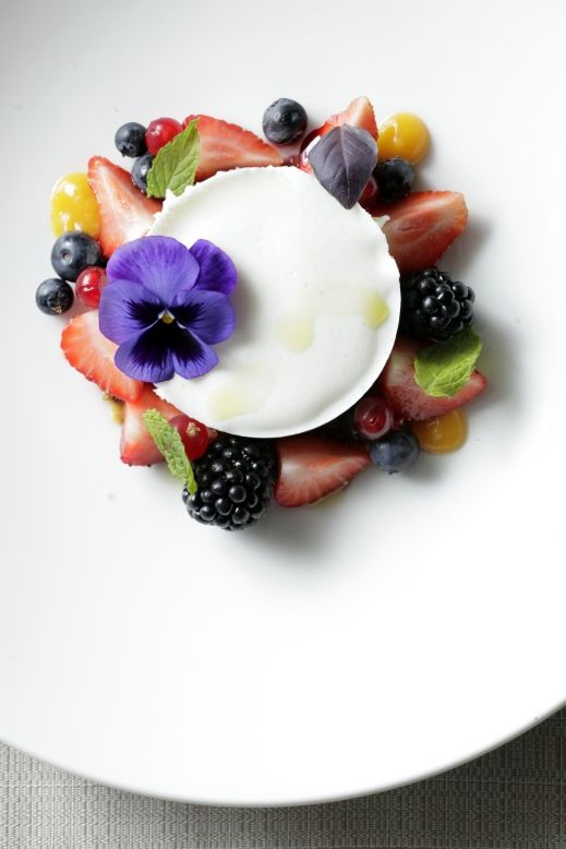 Gorgeous. Panna cotta plating, with lemon curd, honey, zest, mint leaves, berries. Where can I get currants around here?!