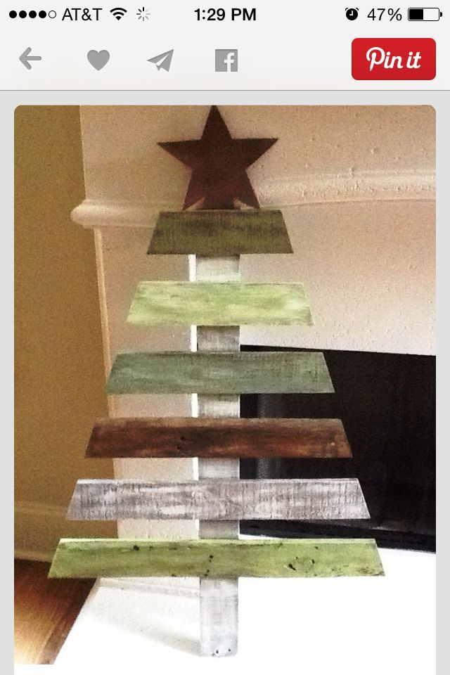 Pallet Christmas tree add some pins and garland use it for Christmas card holder!