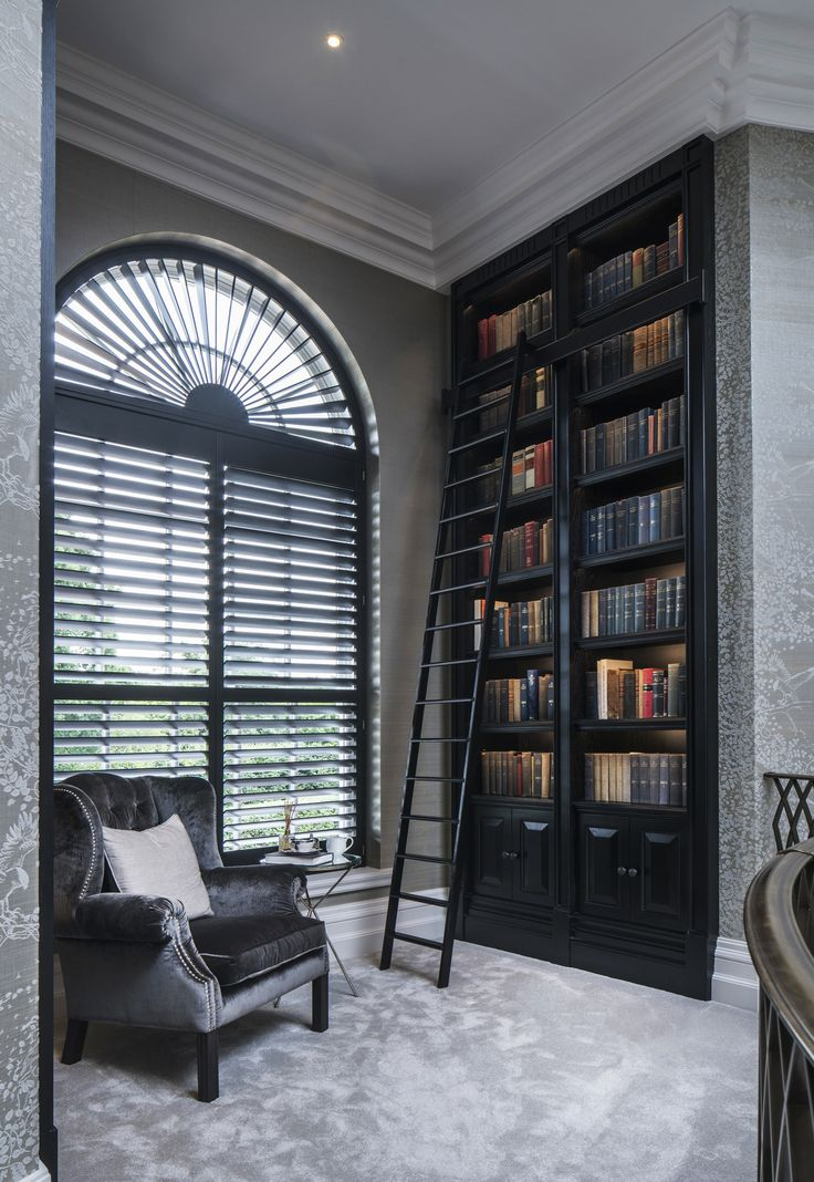 Our interior design of this refined reading room is dramatic and powerful, the dark tones contrasting with the lavish greys to create the perfect atmosphere to indulge in a book.
