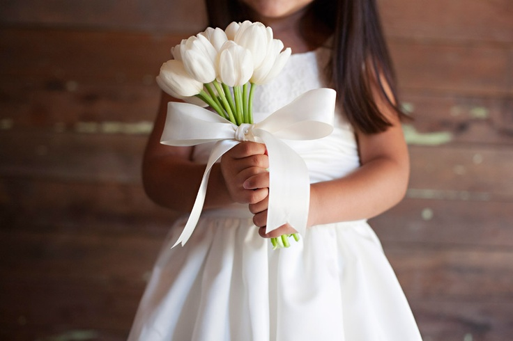 Flower girl with tulip bouquet