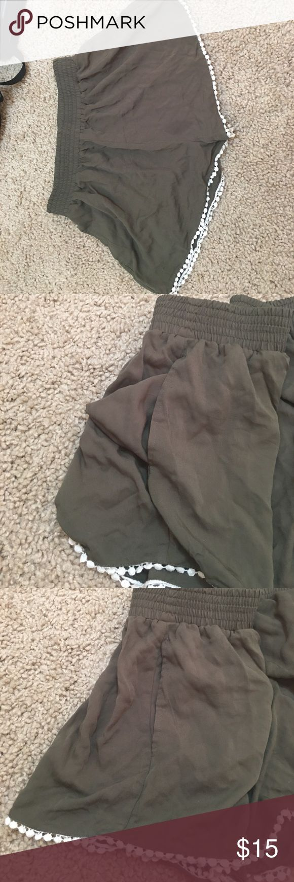 Army green shorts These are army green shorts with a white ball like trim that goes along the whole base of the shorts. They have pockets and are lightly worn. They are really soft and comfortable and fit well. MINKPINK Shorts