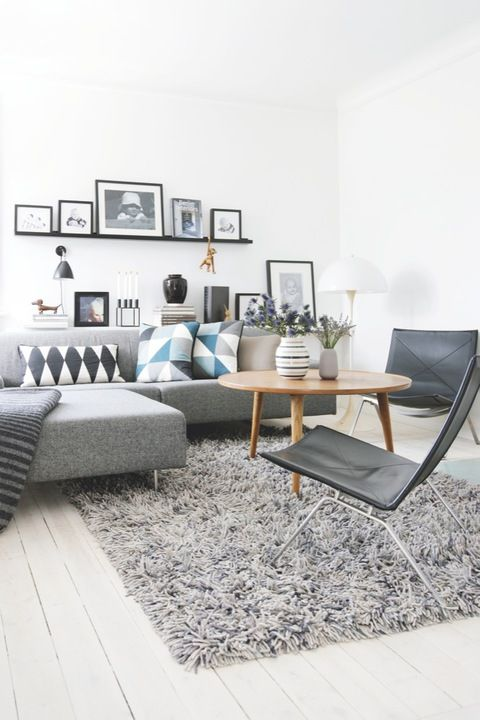 There's a number of our favourite design items in this living room. We love the hit of blue from the Ferm Living Remix Cushions