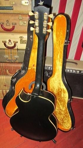 Here's a players 1952 Gibson ES-295 in a killer looking black re-finish.   Guitar was originally gold and is an original ES-295 a la Scotty Moore but it has bee