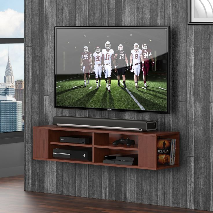 Fitueyes Wall Mounted Audio/Video Console wood grain for xbox one /PS4/ vizio/ Sumsung/sony TV DS212001WB-G. Cutouts adjacent to wall neatly conceal cables and wires. It is a smart design elegant and consise. It includes a strong and tested metal hanging system to fix it on a wall. Not made to support a television of any size. Modern, space saving design.