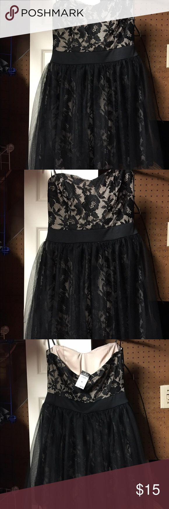 Black and Cream cocktail dress from Rue 21 It has a flower design pattern and is laced. It is a strapless dress. It has never been worn and still has the tags on it. Rue 21 Dresses Strapless