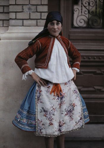 Portrait of a young Serbian-Hungarian peasant in a folk costume. Location: Near Mohacs, Baranya, Hungary.