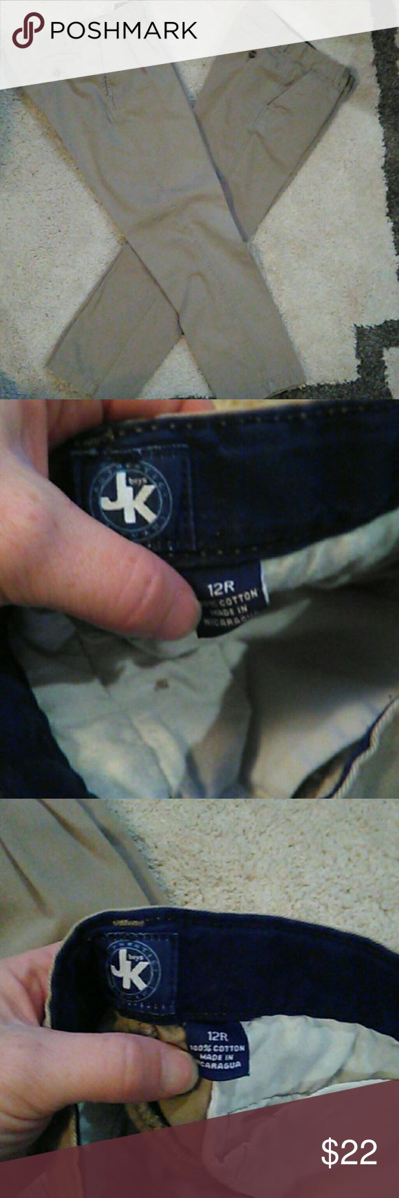 JK Boys Khakis/ School uniform code Khakis zip front with button 2 pockets in back with buttons. Straight leg. Belk's stores brand JK boys Bottoms